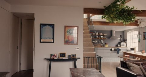 Happy couple walk into their dream home and embrace slow motion steadicam shot