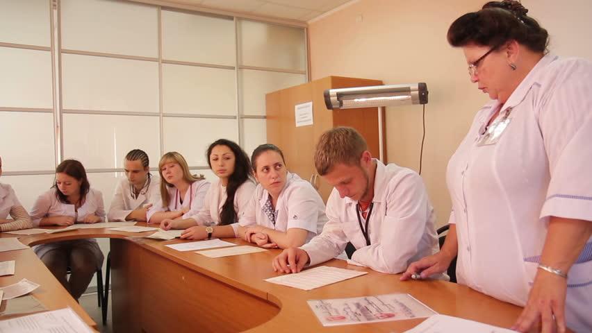 Male Female Multi Ethnic Teenagers Sitting Classroom Desks College ...