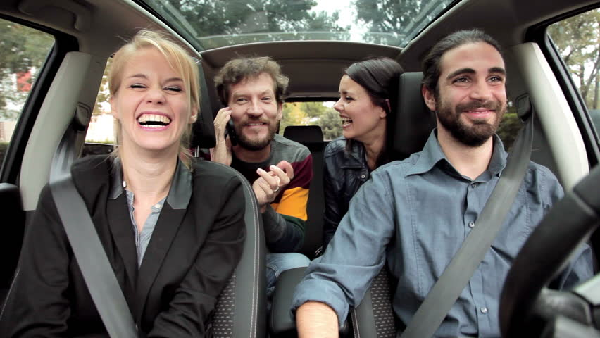 Four Cool Friends In Car Having Fun Dancing And Laughing Stock