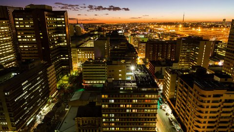 A timelapse of the city centre of Johannesburg (CBD) at night fall tilting down showing New Town and the Sentech Tower. during peak traffic time down(Johannesburg, Gauteng, South Africa - 25/07/2015)