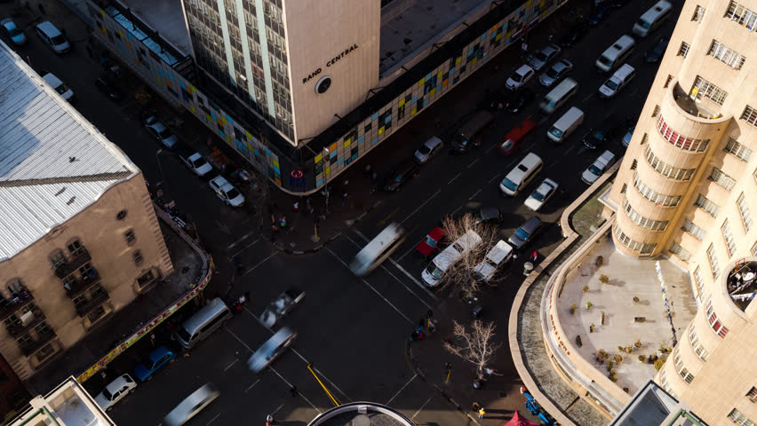A static daytime timelaspe from the Ansteys building shooting down onto a busy street crossing between Jeppe street and Joubert street in the city (Johannesburg, Gauteng, South Africa - 25/07/2015)