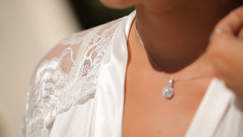 Pendant with diamonds for the bride, wedding on the island of Santorini | Shutterstock HD Video #12388121