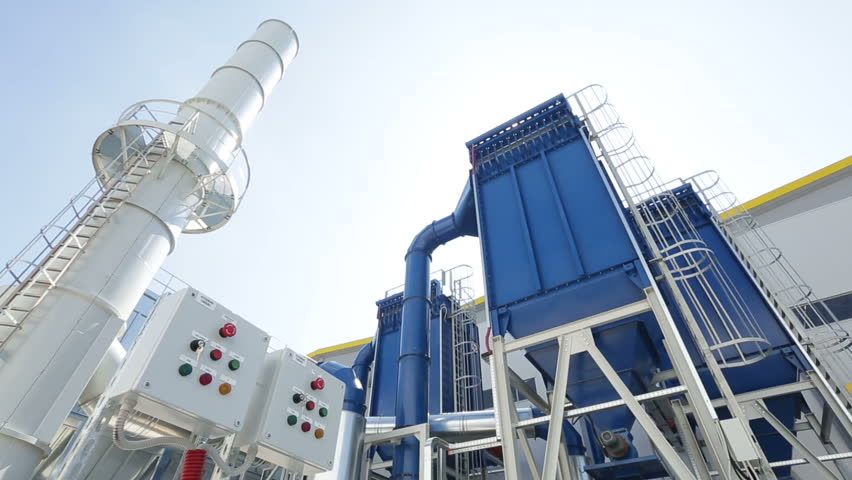 Waste-to-energy facility from the outside. The energy-from-waste is the process of generating energy in the form of electricity or heat from the primary treatment of waste. Tilt.