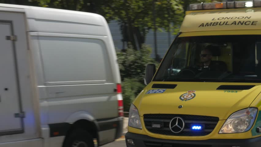 LONDON/ENGLAND SEPTEMBER 10TH 2015 An ambulance speeds through Parliament Square in London to an emergency. Shot in 4K