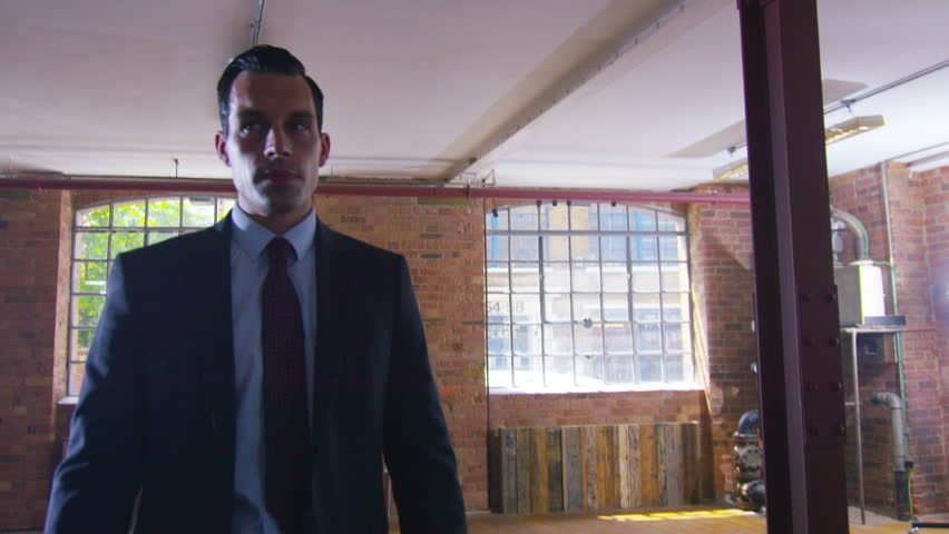 4K Handsome businessman or special agent character outnumbered in a fight against Asian gang. Shot on RED Epic.