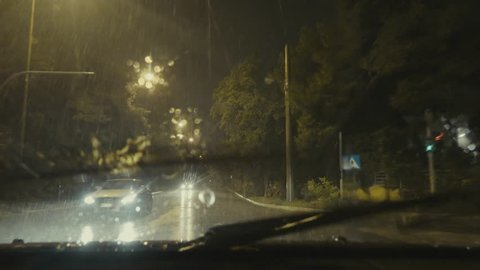 4K driving pov,downtown avenues, night,rain.4K series of driving point of view clips in various streets and locations in the rain.Look below for more shots.Commercial,no logos,licence plates visible.