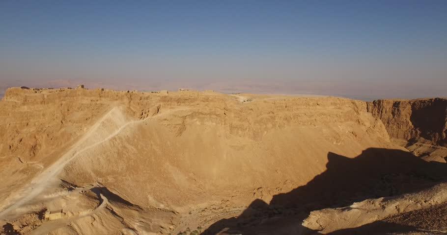 Soaring aerial 4K view MASADA, ISRAEL. Filmed flying the DJI Inspire drone. | Shutterstock HD Video #12509021