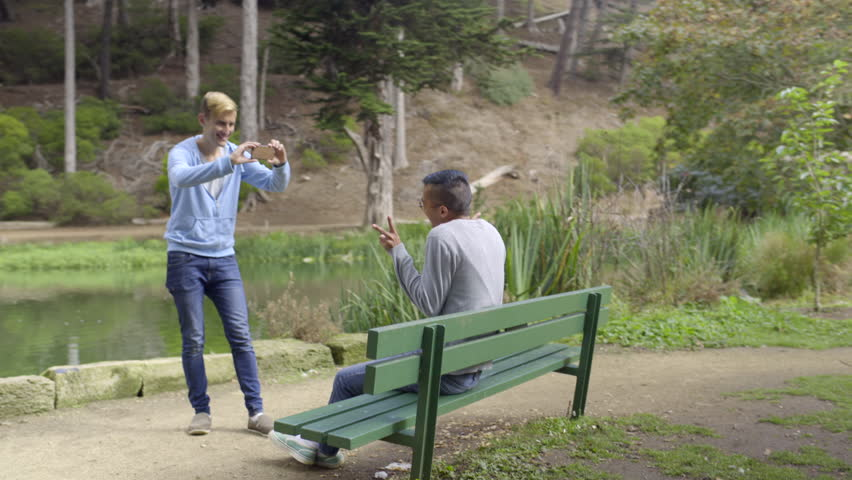 Man Takes Vacation Photos Of His Boyfriend Holding Up Peace Signs In Golden Gate Park, San Francisco  | Shutterstock HD Video #12519761