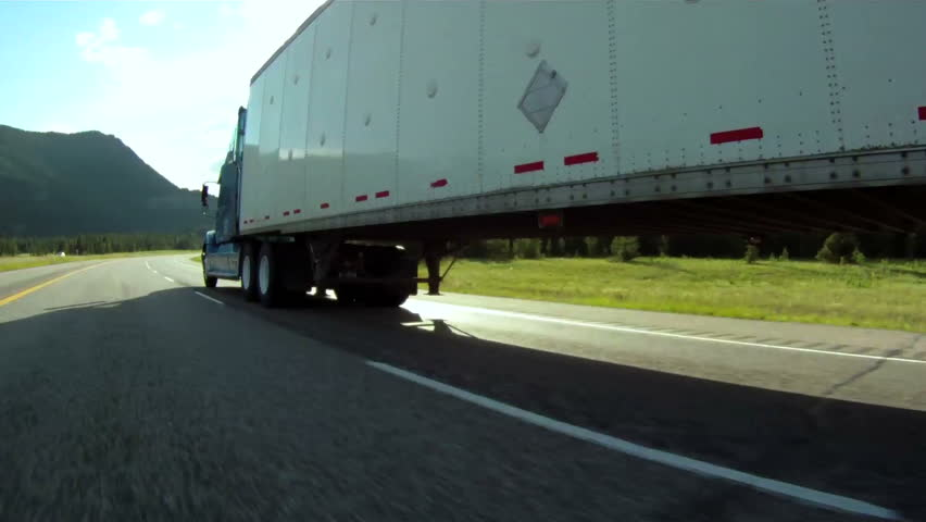 Vehicle pov shot of semi trailer truck traffic on highway #1253650
