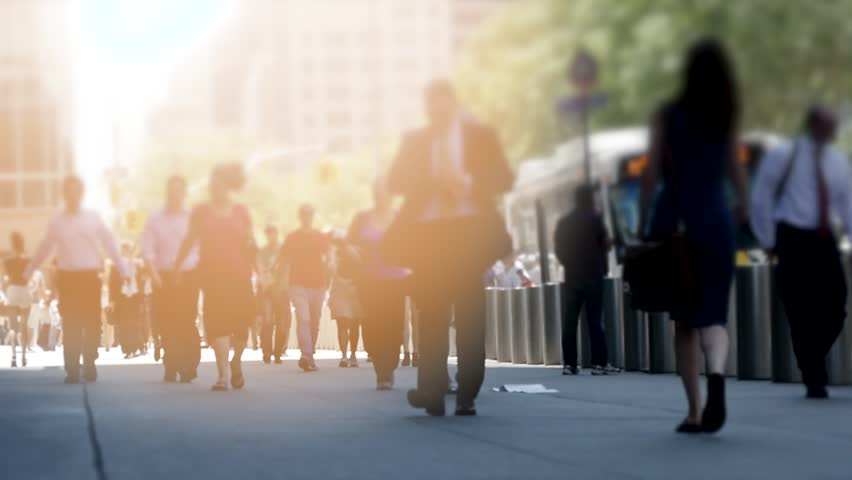 slow motion of people walking in the city. urban lifestyle background. commuters on crowded public street