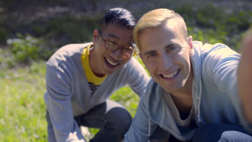 Interracial Gay Couple Take A Selfie With Their Cute Corgi -9530
