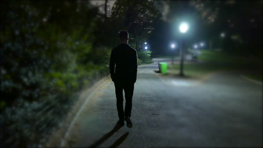 Know, man walking down the street at night