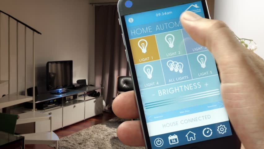 Smart Home - Smart House, Home Automation, Device With App Icons. Man Uses  His Smart Phone With Smarthome Security App To Turn On The Lights Of His  House.