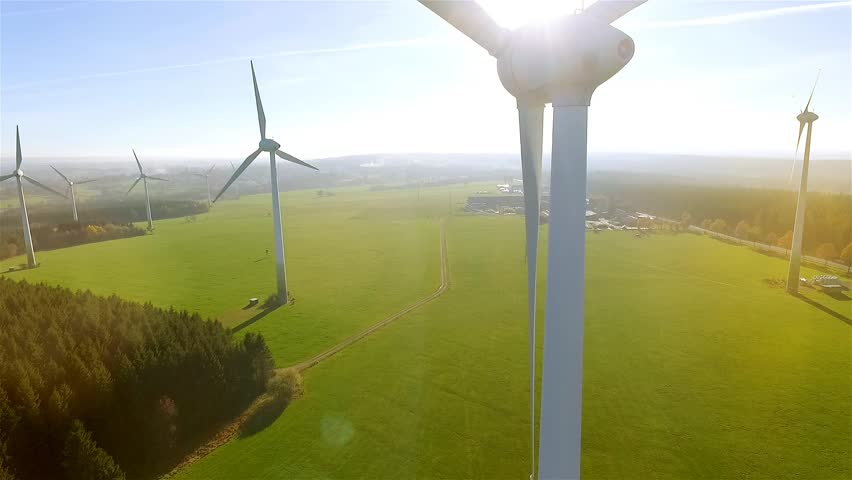 Windmill / Wind power technology - Aerial drone view on Wind Power, Turbine, Windmill, Energy Production - Green technology, a clean and renewable energy solution | Shutterstock HD Video #12603890