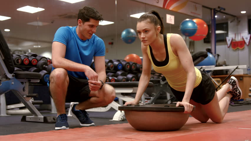 Woman doing push ups with trainer in high quality 4k format