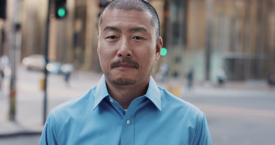 Slow Motion Portrait of Japanese businessman smiling in city real people series | Shutterstock HD Video #12659165