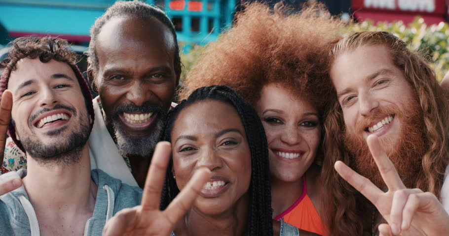 Slow Motion Portrait of happy multi ethnic group of people smiling in the city peace sign real people series | Shutterstock Video #12665741