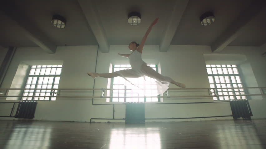 graceful girl practicing ballet in the Studio, slow motion , does pirouettes