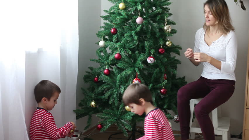 Two boys and their mother, decorating Christmas tree   Shutterstock HD Video #12680621