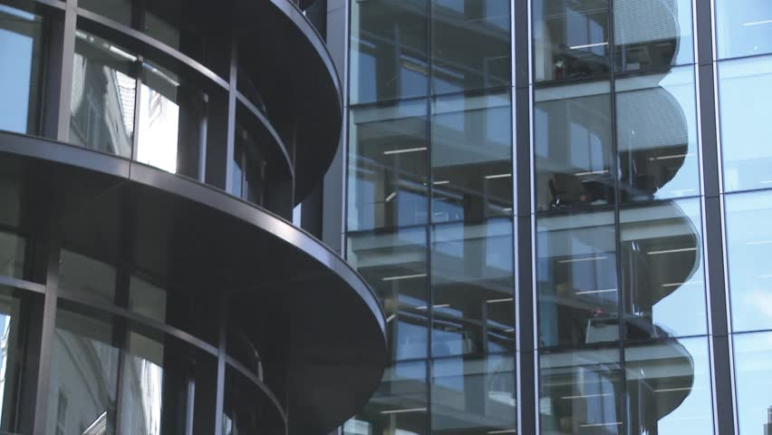 Tilt up Close up of modern office buildings glass fronts   | Shutterstock HD Video #1271305
