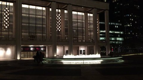 NEW YORK CITY - CIRCA 2015: Night time NX establishing shot of fountain and tourists at Lincoln Center and Philharmonic, Center for Performing Arts