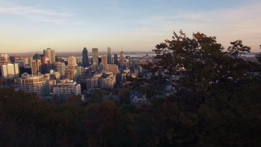 4K aerial drone shot of montreal skyline at sunset forward move