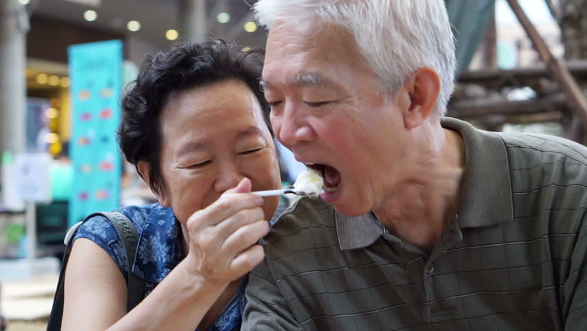 Asian senior couple eating an ice cream and feed each other abstract eternal love #12737012