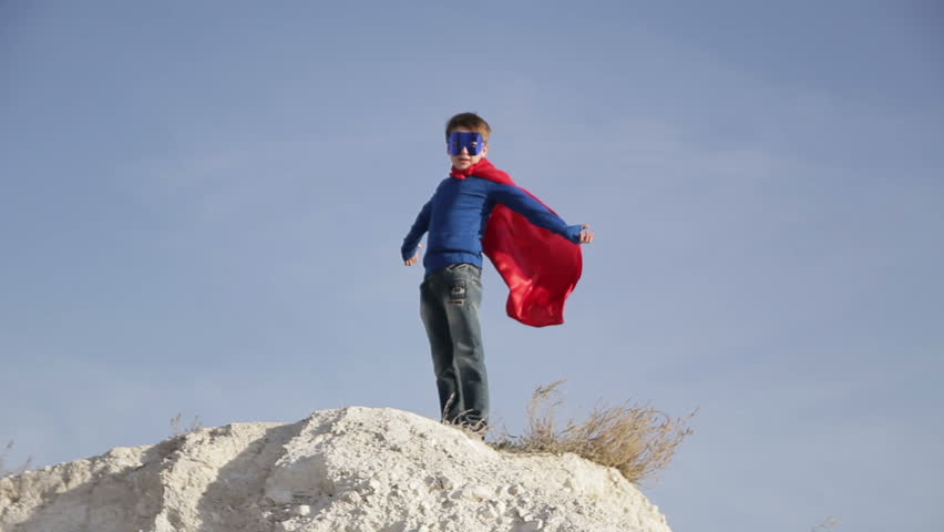 Superhero boy  runs through the mountains and trying to fly   Shutterstock HD Video #12750872