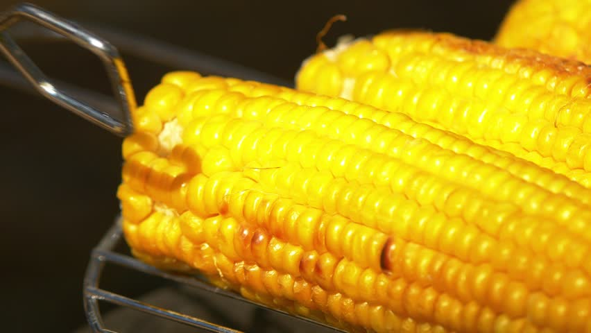 Boiled corn cob stock footage video 2624273 shutterstock healthy vegetarian delicious barbecue with ripe golden corn on coals and turn it around by using ccuart Choice Image