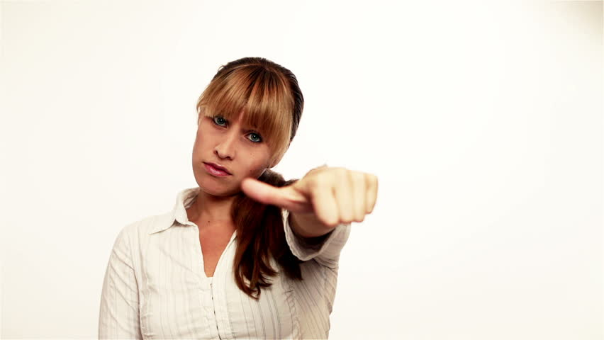 Attractive woman holding thumbs down and then up   Shutterstock HD Video #1277410