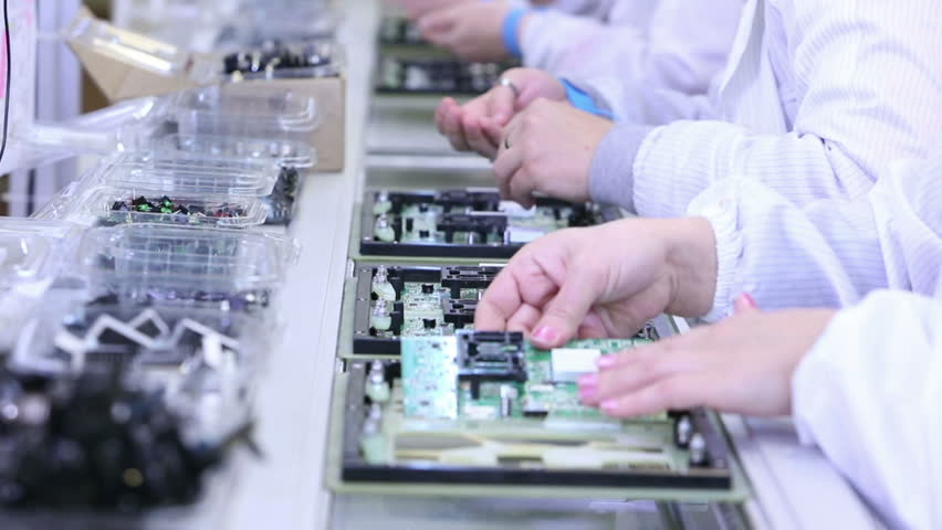 Workers are manufacturing Circuit Boards in Electronics Factory - Assembly line of LEDs, Transistors and other Electronic components being installed | Shutterstock HD Video #12791711
