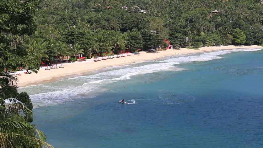 KOH PHANGAN,THAILAND - NOVEMBER 21, 2015: Thong Nai Pan Noi beach and sea water waves. Koh Phangan Island is one of the most popular destinations for tourists | Shutterstock HD Video #12899405