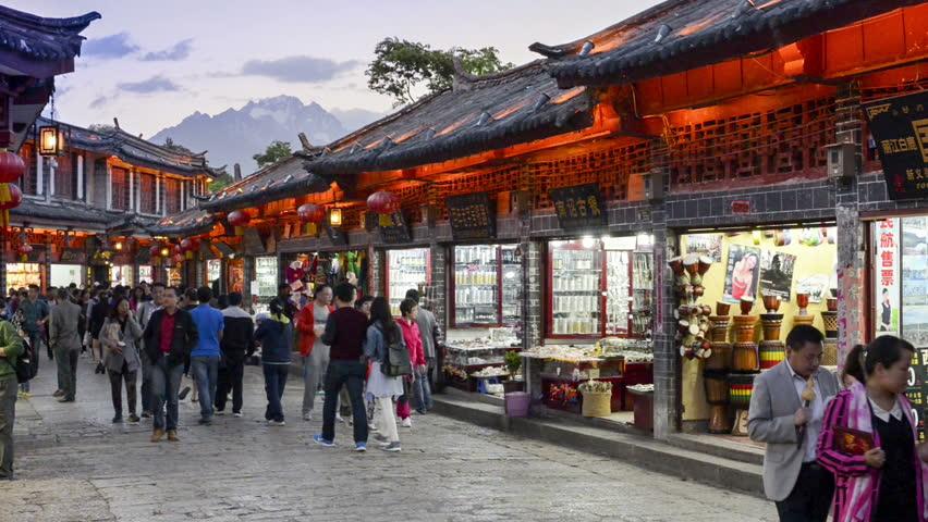 Lijiang, China - April  4, 2014: People are walking in the Old Town of Lijiang, Yunnan Province, China.