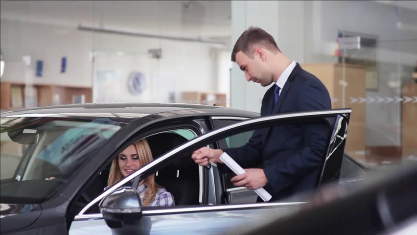 Car Sales Manager Communicating With Customer In A Motor Show Stock ...