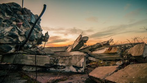 Apocalypse.Sunset over the wreckage of buildings
