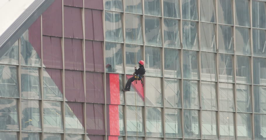Extreme Dangerous Job Cleaning Windows On Skyscraper Business Tower ...
