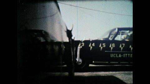 UNITED STATES 1960s – Test cars crash. Crash test dummies in car during impact.