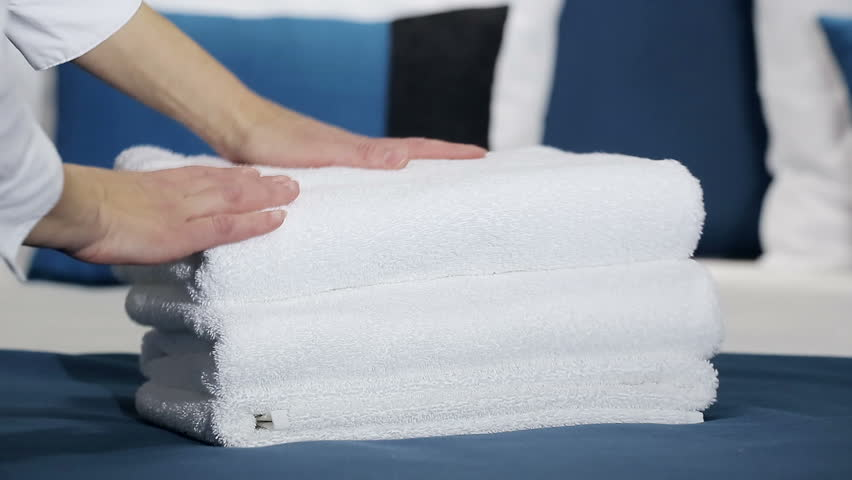 Hotel: Maid cleans the room at the hotel
