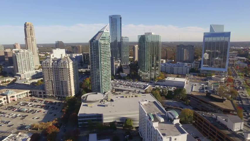 A daytime aerial establishing shot of Buckhead, an affluent uptown district of Atlanta, Fulton County, Georgia.