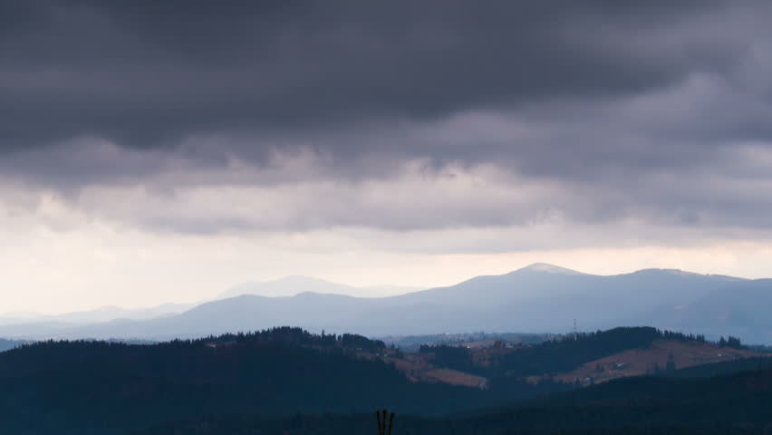 Dark clouds moving over the tops of the Carpathian mountains in a landscape of hills and pine trees. TimeLapse | Shutterstock HD Video #13040411