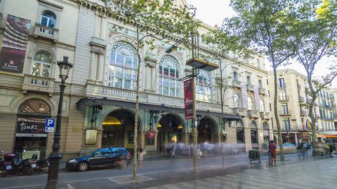 Motion timelapse (hyperlapse, time lapse, time-lapse) of the theater del Liceu at the famous La Rambla street in Barcelona, Spain.
