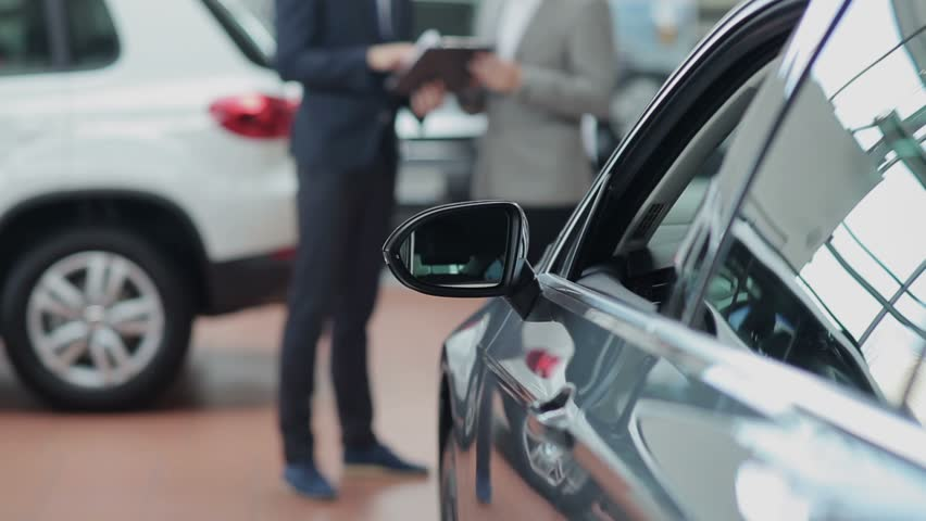Seller Car >> Blurred Customer And Seller Behind A Car In Motor Show Stock Footage