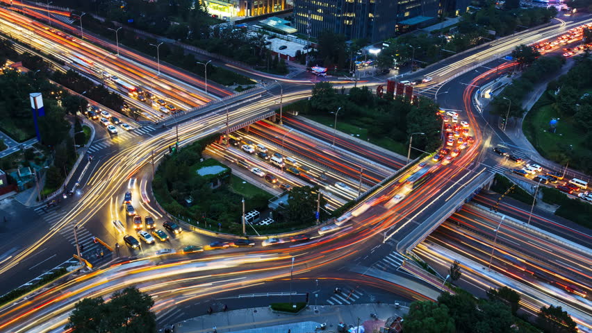 4K(4096x2304): Aerial View of freeway busy city rush hour heavy traffic jam highway. Timelapse of driving & cars racing by with streaking lights trail at night.