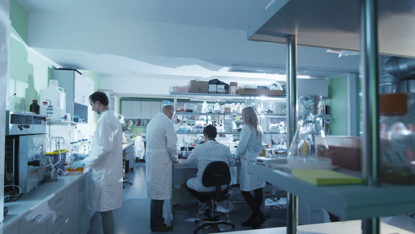 Timelapse footage of a team of scientists in white coats that are working in a modern laboratory. Shot on RED Cinema Camera in 4K (UHD). #13089521