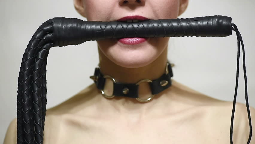 slave attractive woman with whip in mouth