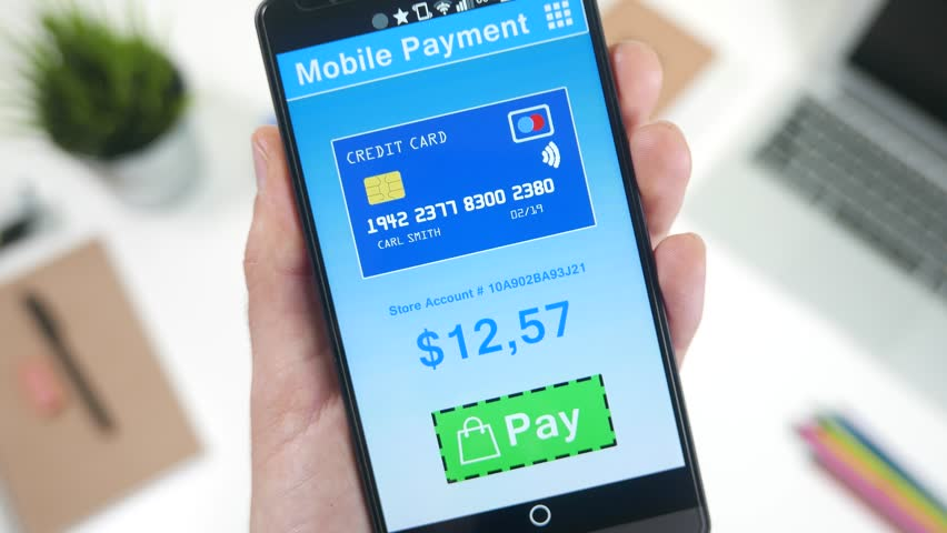 Pressing PAY button on smartphone online shopping application.