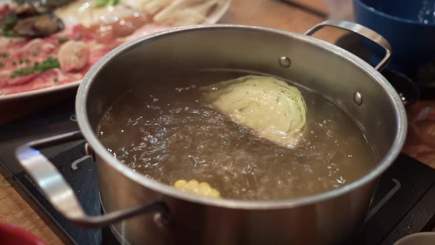 Stock video of put the raw food to sukiyaki 13137641 shutterstock forumfinder Image collections