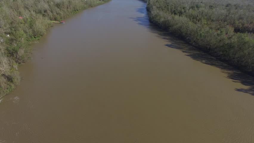 Aerial shot of Louisiana bayou and muddy river