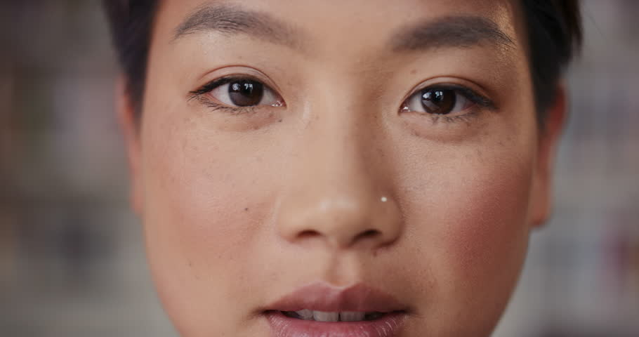 Dramatic Close up of beautiful Asian woman happy portrait happy smiling slow motion soft natural light on face center crop