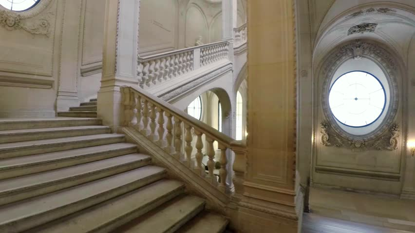 PARIS, FRANCE - AUTUMN, 2015: The magnificent staircase in the Louvre Museum in Paris. France. Shot in 4K (ultra-high definition (UHD)).